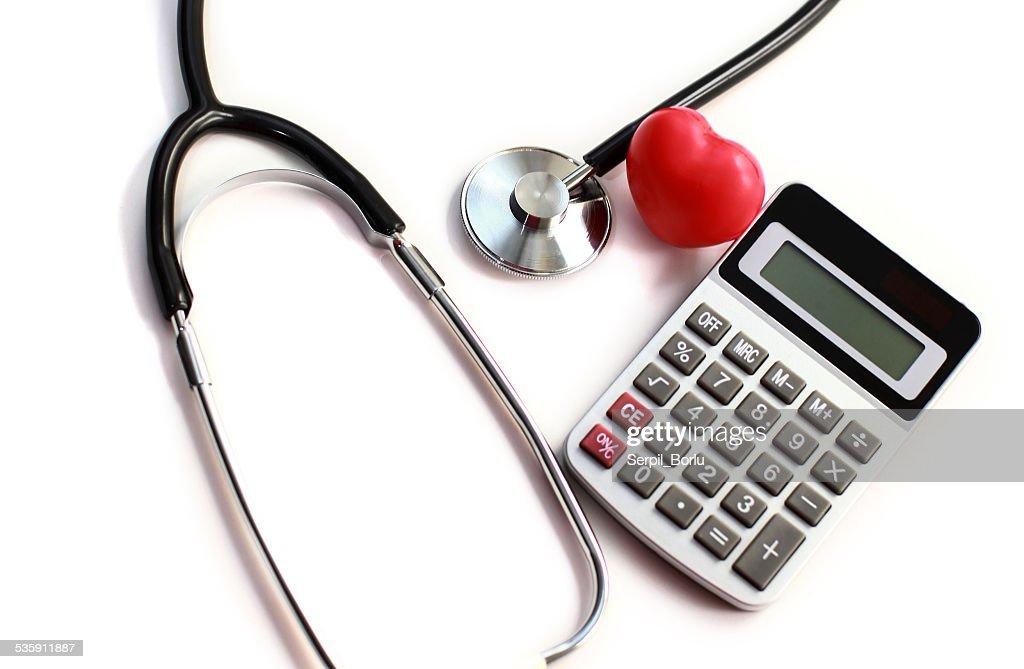 Heart Care and calculator : Stock Photo