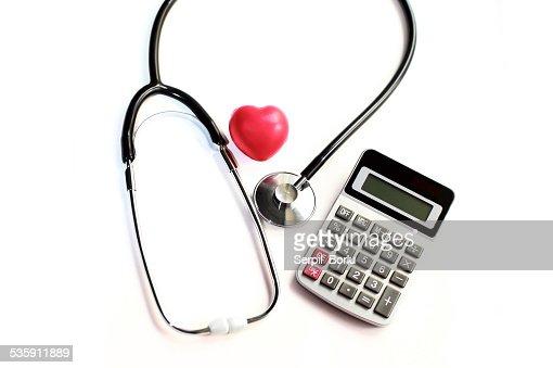 Coração cuidado e calculadora : Foto de stock