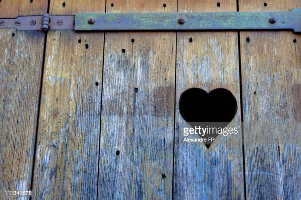 Heart carved in old wooden shutters