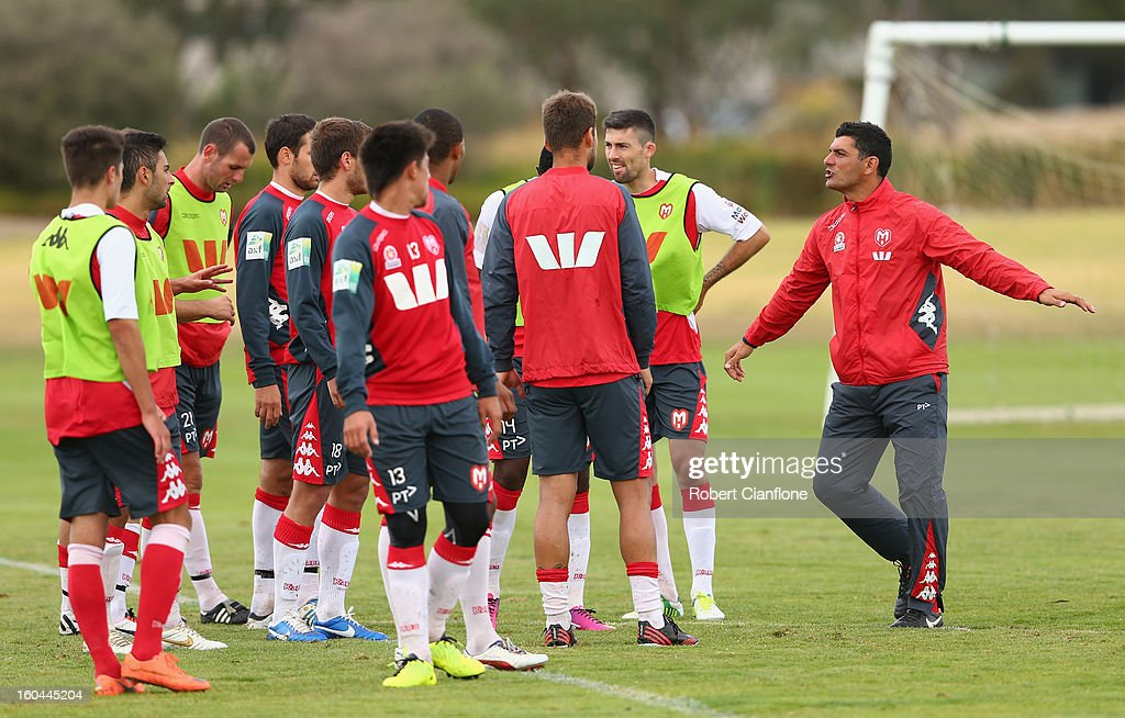 Heart coach <a gi-track='captionPersonalityLinkClicked' href=/galleries/search?phrase=John+Aloisi&family=editorial&specificpeople=171530 ng-click='$event.stopPropagation()'>John Aloisi</a> talks to the players during a Melbourne Heart A-League training session at La Trobe University Sports Fields on February 1, 2013 in Melbourne, Australia.