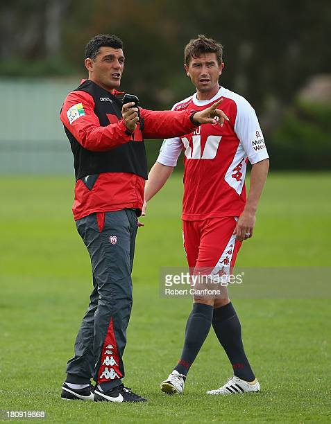Heart coach John Aloisi talks with Harry Kewell during a Melbourne Heart ALeague training session at the La Trobe University Playing Fields on...