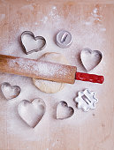 Heart cookie cutters and cookie dough