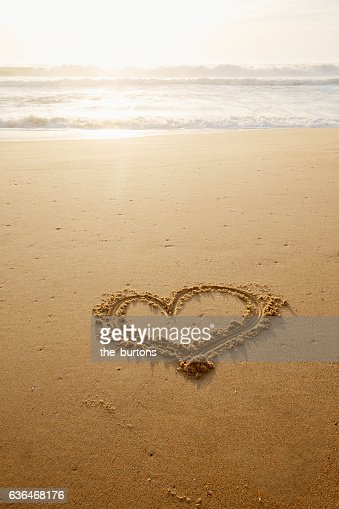 Heart Drawn In The Sand On An Empty Beach During Sunset ...