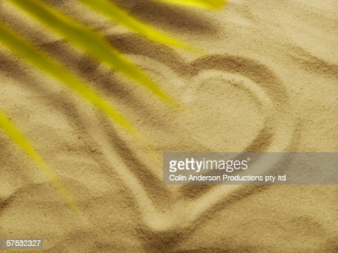 Heart drawn in the sand : Stock Photo