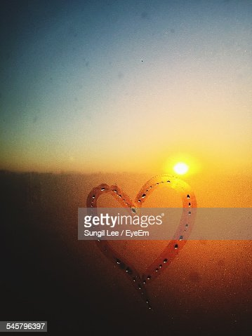 Heart Drawn On Condensed Window