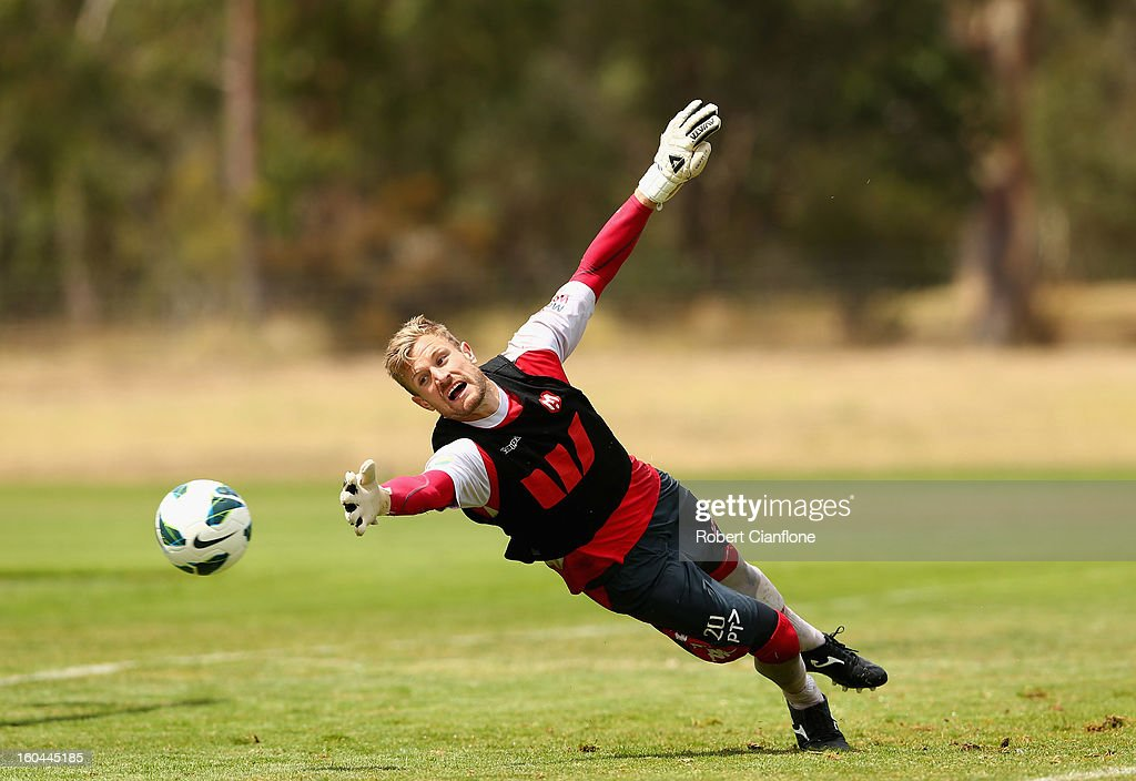 Heart goalkeeper Andrew Redmayne dives for the ball during a Melbourne Heart A-League training session at La Trobe University Sports Fields on February 1, 2013 in Melbourne, Australia.