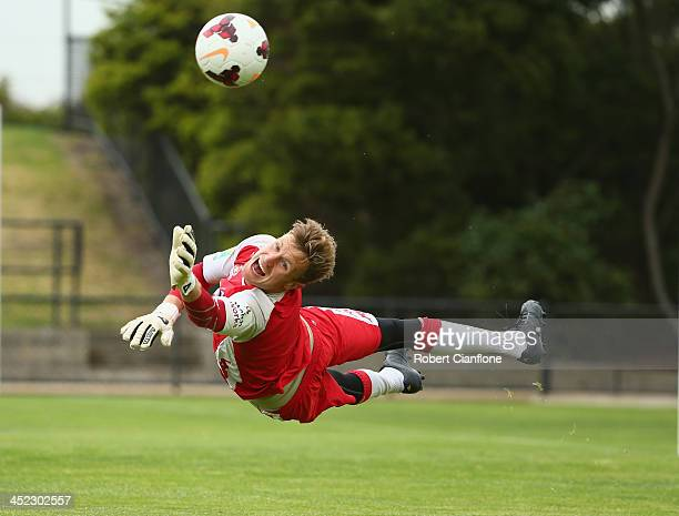 Heart goalkeeper Andrew Redmayne makes a save during a Melbourne Heart ALeague training session at Epping Stadium on November 28 2013 in Melbourne...