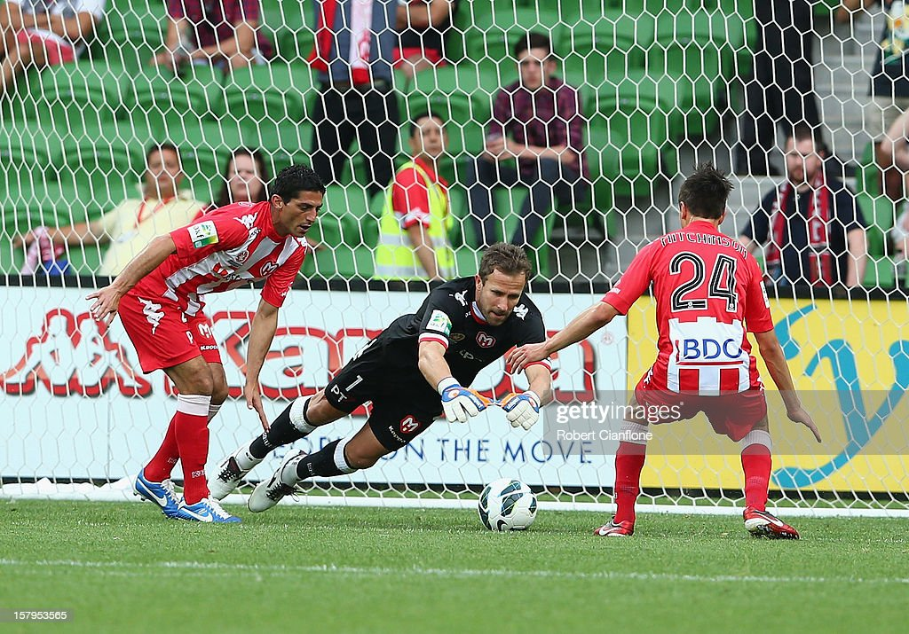 Heart goalkeeper <a gi-track='captionPersonalityLinkClicked' href=/galleries/search?phrase=Clint+Bolton&family=editorial&specificpeople=227070 ng-click='$event.stopPropagation()'>Clint Bolton</a> makes a save during the round 10 A-League match between the Melbourne Heart and the Perth Glory at AAMI Park on December 8, 2012 in Melbourne, Australia.