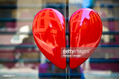 Heart handles on shop door on Via della Spiga. : Stock Photo