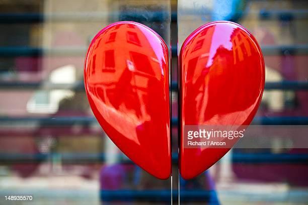 Heart handles on shop door on Via della Spiga.