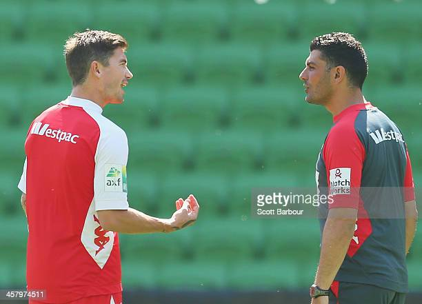 Heart head coach John Aloisi speaks with Harry Kewell during a Melbourne Heart ALeague training session at AAMI Park on December 20 2013 in Melbourne...