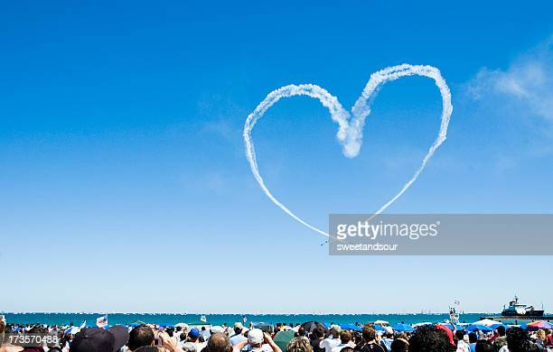 Heart made out of a planes smoke trail