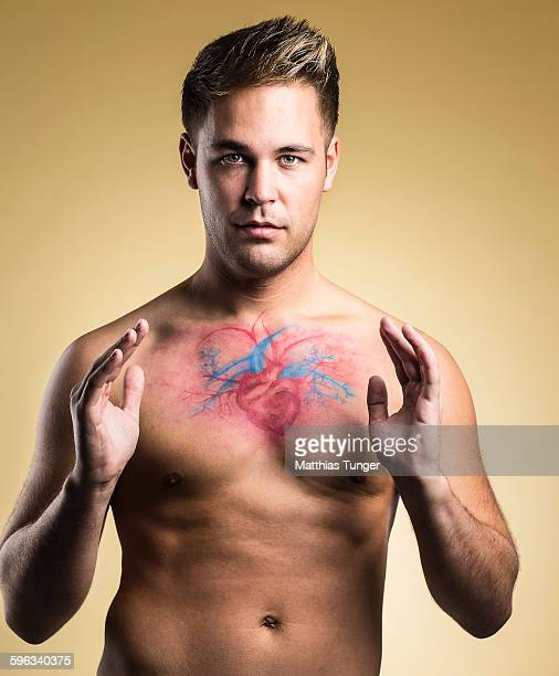 Heart of a man diagrammed on his chest