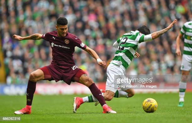 Heart of Midlothian's Bjorn Johnsen and Celtic's Callum McGregor battle for the ball during the Ladbrokes Scottish Premiership match at Celtic Park...