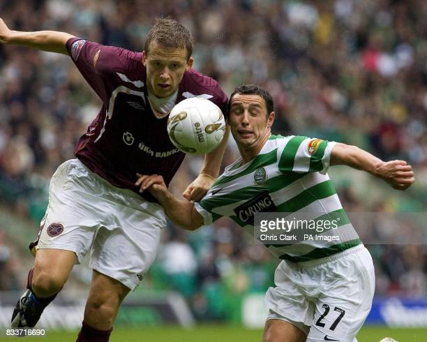 Heart of Midlothian's Christophe Berra battles with Scott McDonald of Celtic during the Clydesdale Bank Scottish Premier League match at Celtic Park...