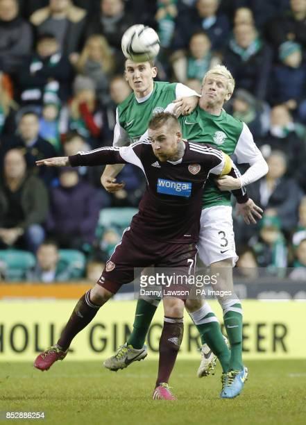 Heart of Midlothian's Ryan Stevenson and Hibernian's Ryan McGivern battle for the ball during the Scottish Premiership match at Easter Road Edinburgh