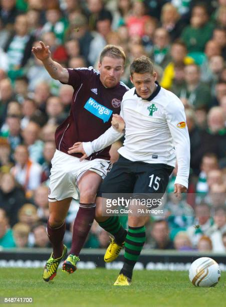 Heart of Midlothian's Ryan Stevenson tackles Celtic's Kris Commons during the Clydesdale Bank Scottish Premier League match at Celtic Park Glasgow