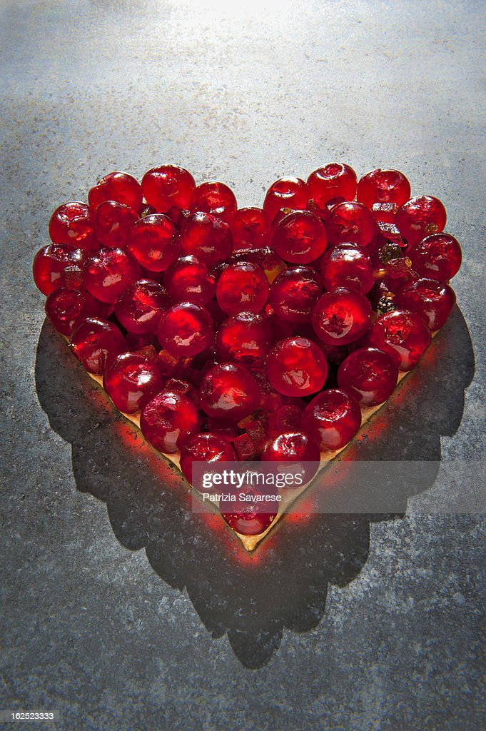 Heart of red cherries : Stock Photo