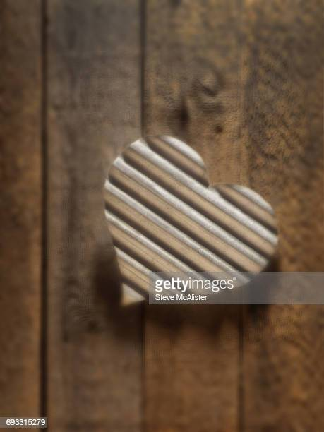 Heart on Wood Plank Background
