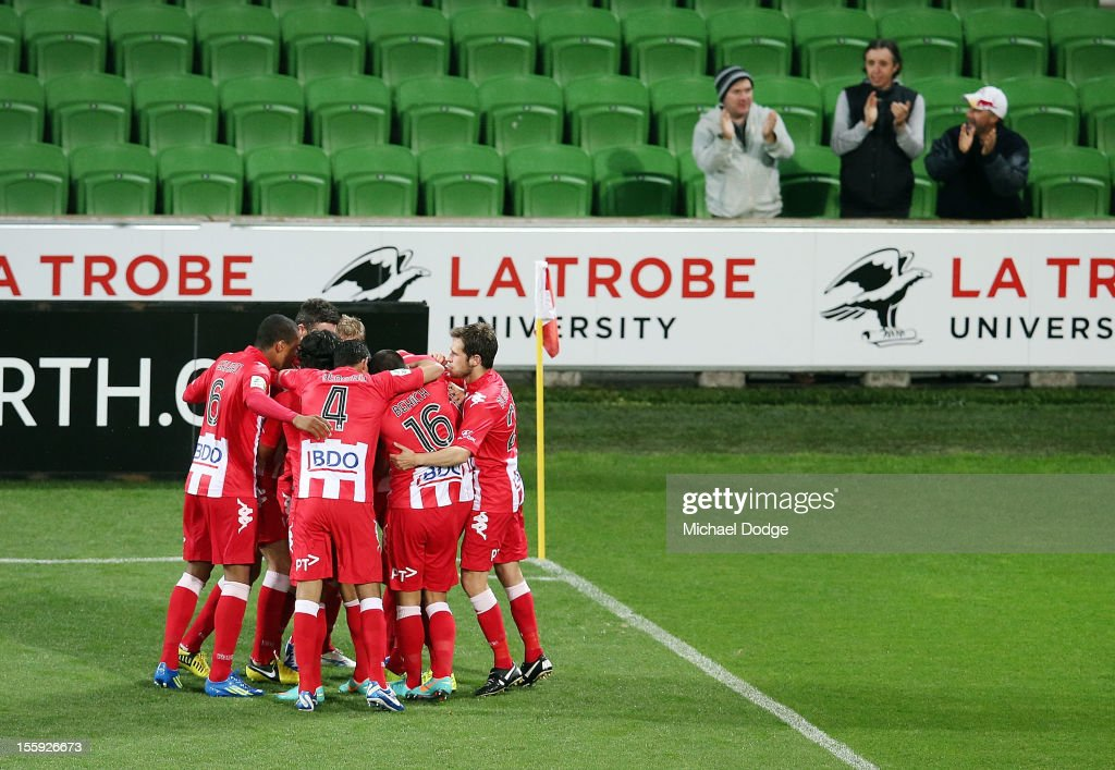 Heart players celebrate a goal by Richard Garcia during the round six A-League match between the Melbourne Heart and the Brisbane Roar at AAMI Park on November 9, 2012 in Melbourne, Australia.