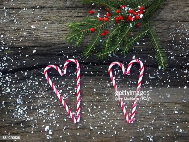 Heart shape candy cane and christmas tree on wood