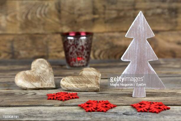 Heart Shape Decorations And Tea Light Candle On Wooden Table During Christmas