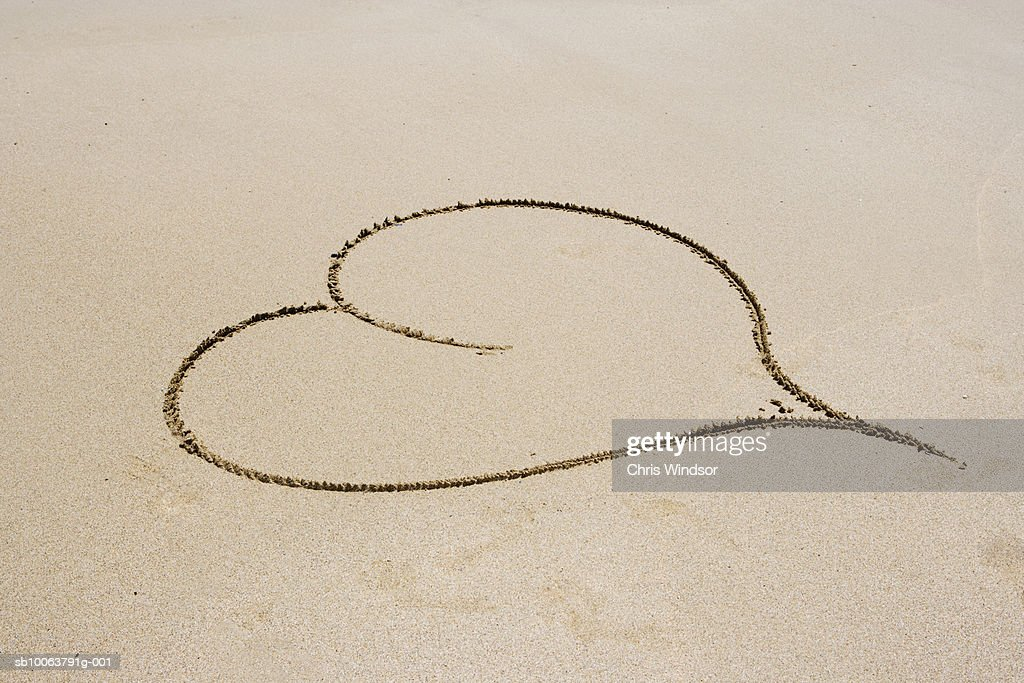 Heart shape drawn in sand : Stock Photo