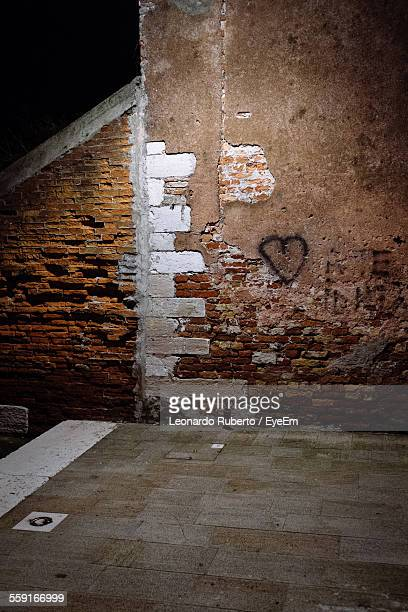 Heart Shape Drawn On Brick Wall During Night