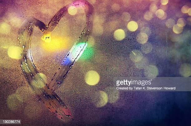 Heart shape drawn on wet window pane
