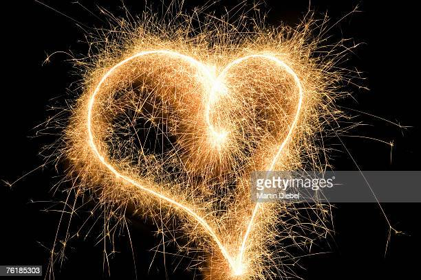 A heart shape drawn with a sparkler