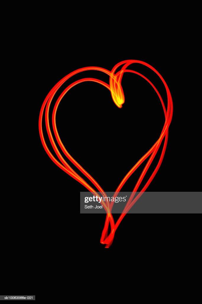 Heart shape drawn with light : Stock Photo