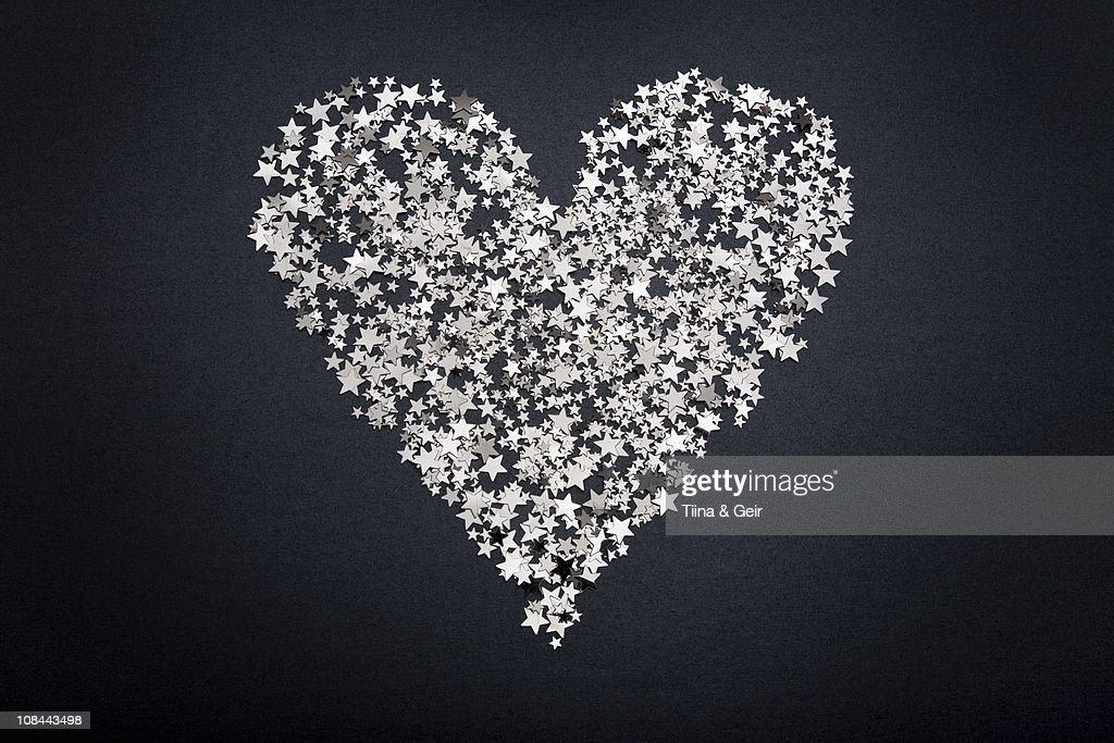 Heart shape figure made of small stars : Stock Photo