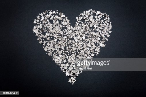 Heart shape figure made of small stars : Stock Photo