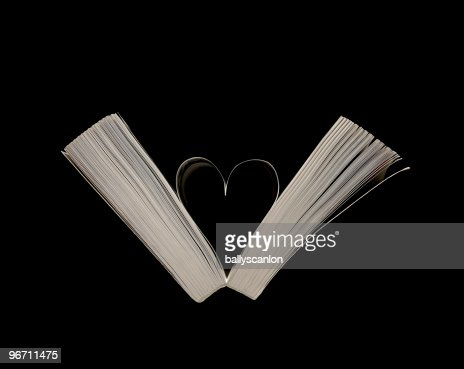 Heart shape formed from pages in book. : Stock Photo