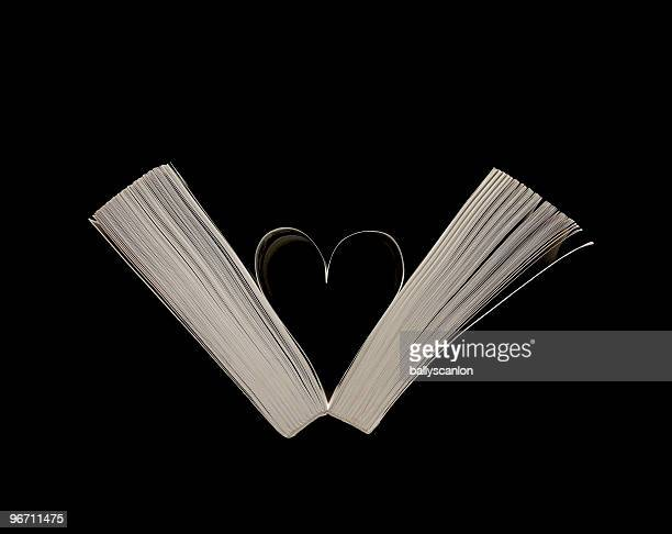Heart shape formed from pages in book.