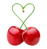 Isolated cherries. Two heart shape cherry isolated on white background