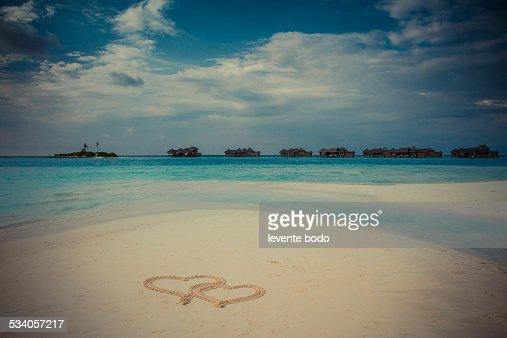 Heart shape in the sand on a tropical beach