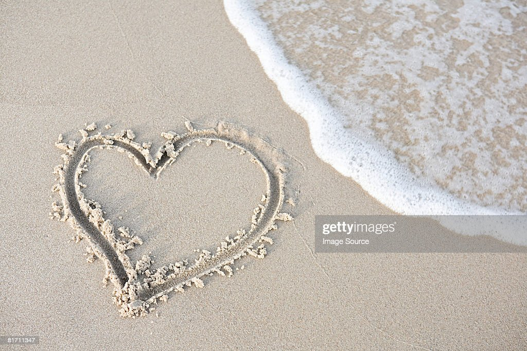 Heart shape in the sand : Stock Photo