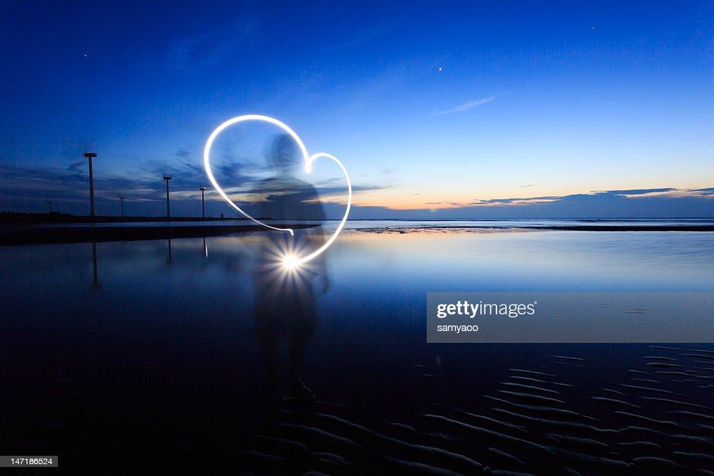 Heart shape light drawing : Stock Photo