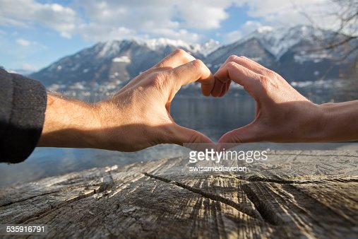 Heart shape made by hands. Outdoors : Stock Photo