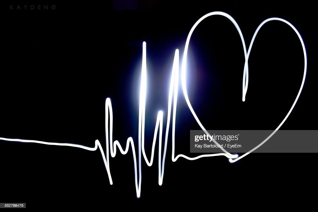 Heart Shape Made From Pulse Trace On Black Background