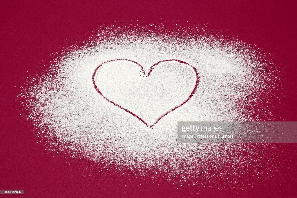 Heart shape made on icing sugar