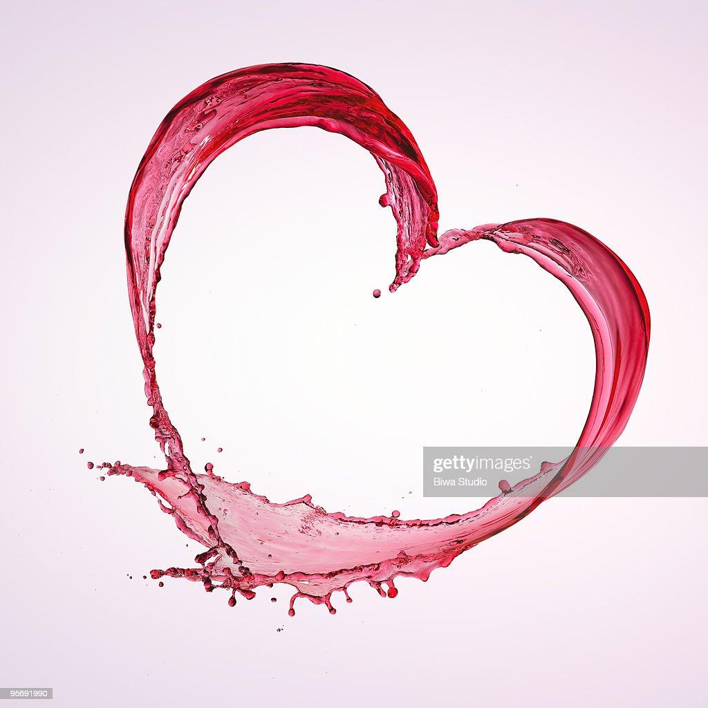 Heart shape of red splash water : Stock Photo