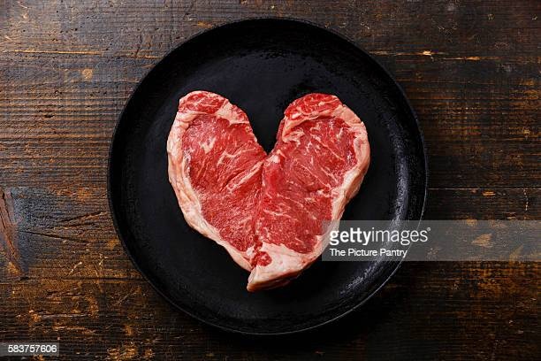 Heart shape Raw fresh meat Steak Striploin for two on frying pan