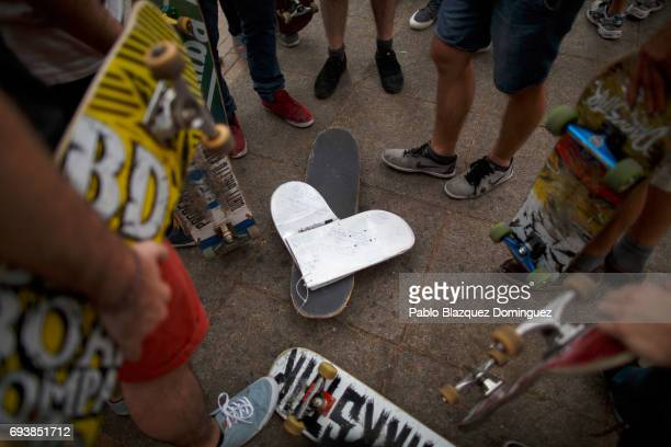 A heart shape skateboard with messages form skaters lays on the ground during a vigil in tribute to Ignacio Echavarria a victim of the London terror...