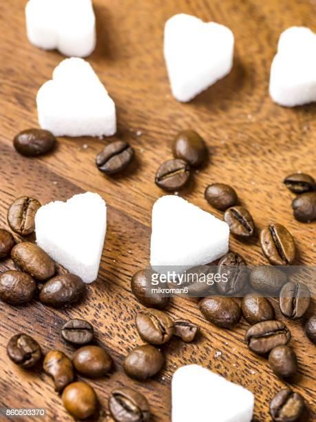 Heart Shape Sugar Cube and roasted coffee beans. Sweet dessert