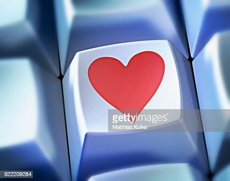 Heart Shape Symbol On Computer Key Stock Photo Getty Images