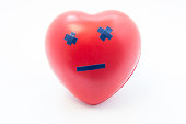 Heart shape with emotion dead smile. Concept photo visualizing death, broken heart of love, failure, cardiac arrest, myocardial infarction, severe cardiac disease or cardiovascular system