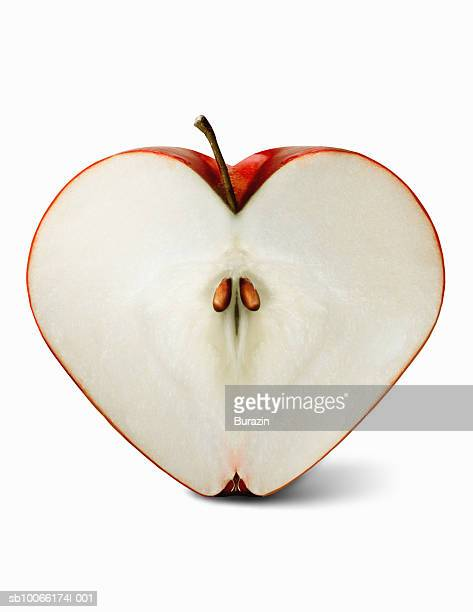 Heart shaped apple sliced in half, close-up