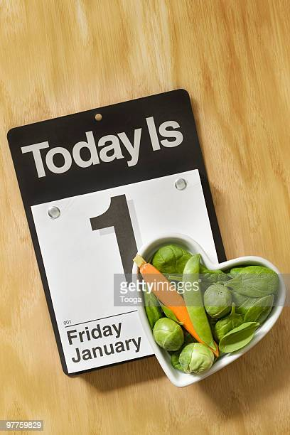 Heart shaped bowl of veggies and calender